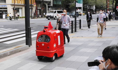 red DeliRo delivery robot on Japan sidewalk
